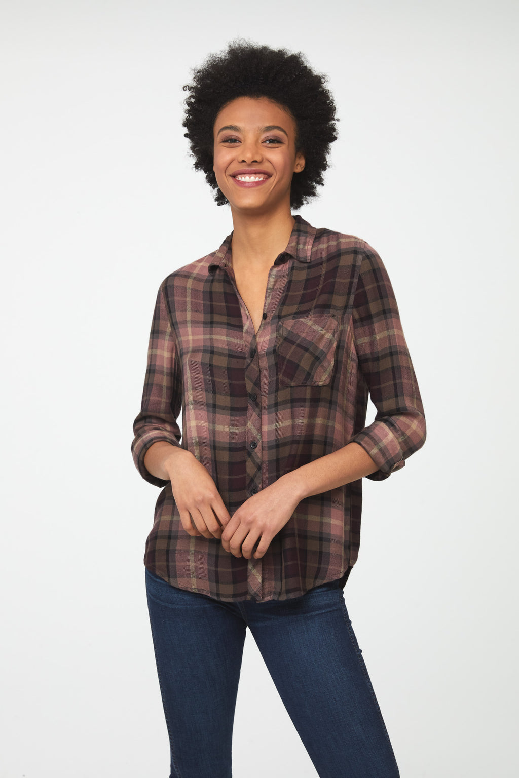 woman wearing a long sleeve button-down shirt in pink and brown plaid with single chest pocket
