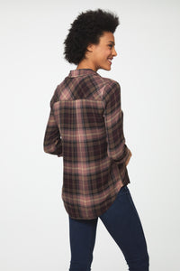 back view of woman wearing a long sleeve button-down shirt in pink and brown plaid with single chest pocket