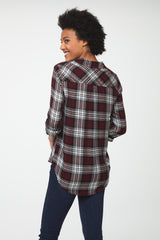 back view of Woman wearing a relaxed, long sleeve V-neck burgundy plaid shirt with white accents and a single patch chest pocket