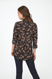 back view of woman wearing a black, long sleeve button-down blouse with leopards, single chest pocket and drop back hem