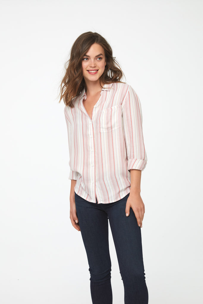 woman wearing a pink and white stripped, long sleeve, button-down shirt