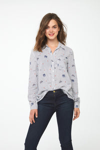 woman wearing a button-down, Blue and White Striped long sleeve Blouse with Paris-inspired print, single chest pocket and drop back hem