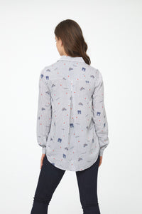 Back view of woman wearing a button-down, Blue and White Striped long sleeve Blouse with Paris-inspired print, single chest pocket and drop back hem
