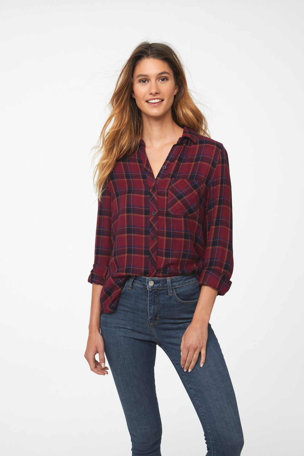 woman wearing a long sleeve, button-down, crimson red plaid shirt with single chest pocket