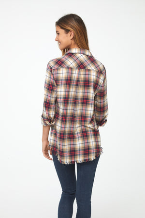 Back view of Woman wearing long sleeve, button front flannel shirt in red, yellow, and blue plaid with frayed hem detailing