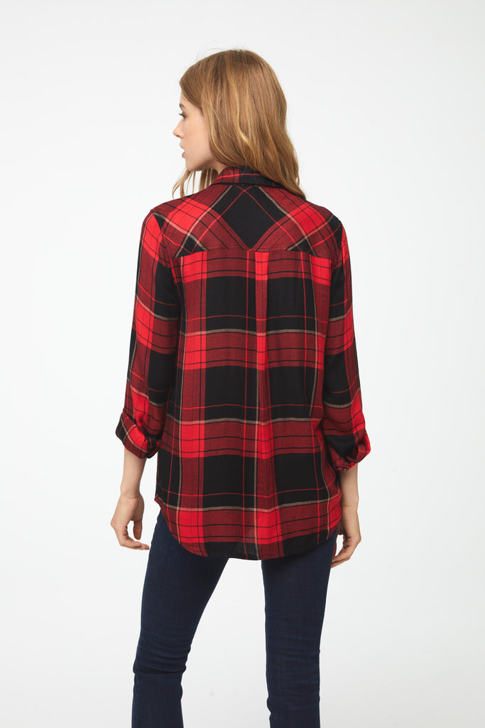 back view of woman wearing a long sleeve, button-down, fire red plaid shirt with single chest pocket