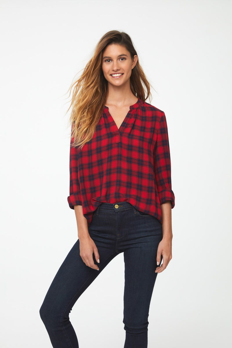 Woman wearing Long Sleeve, Relaxed Fit V-Neck Shirt in red and black plaid