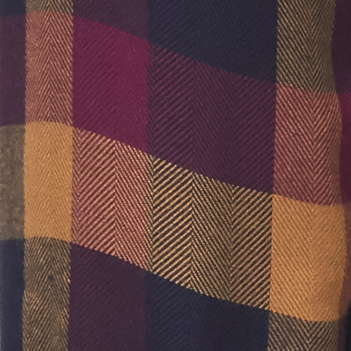 black, red, and gold plaid pattern fabric