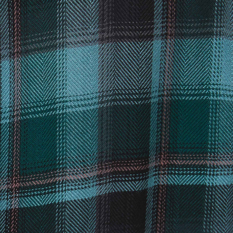 Green and blue plaid fabric with brown accents