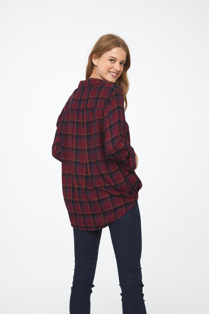 Back view Woman wearing a burgundy plaid, Long Sleeve Collared V-Neck Shirt with Wrap Silhouette and Elastic Bottom Hem