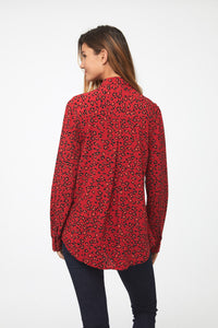 back of side view of Woman wearing a classic, long sleeve button down, collared shirt with single chest pocket and drop hem back in red leopard print