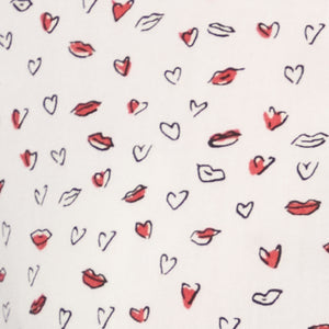 white shirt with heart and red lips print