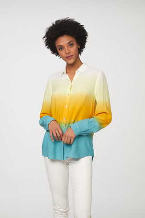woman wearing a long sleeve, button-down, yellow, blue and white dip dye shirt