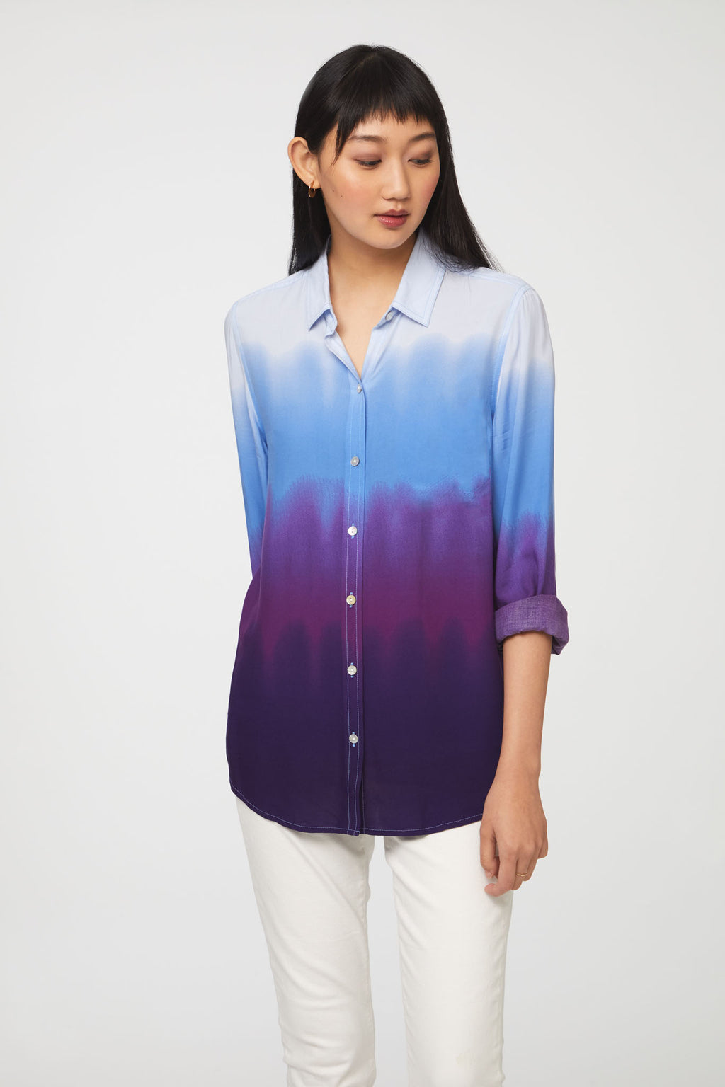 woman wearing a long sleeve, button-down, blue and purple dip dye shirt