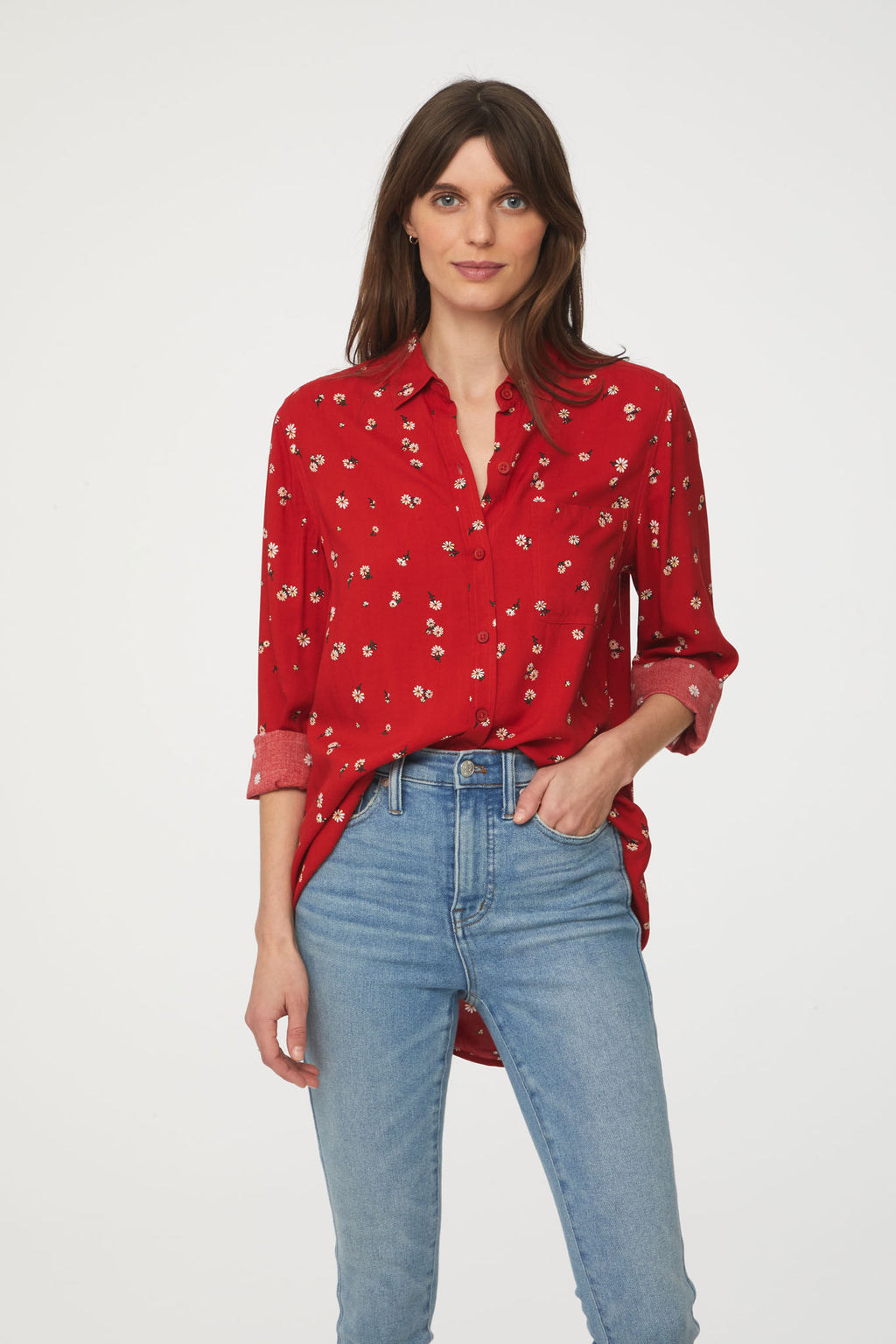 woman wearing a long sleeve, button-down, red floral shirt with single chest pocket