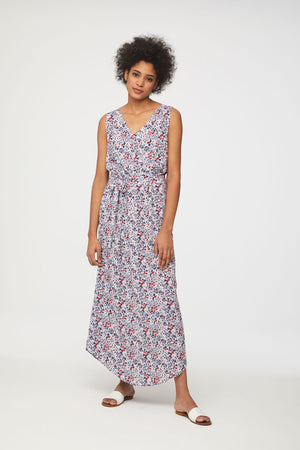 Woman wearing sleeveless floral maxi dress by beachlunchlounge