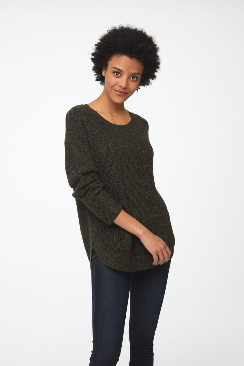 Woman wearing a long sleeve, crew neck sweater in olive green color; front