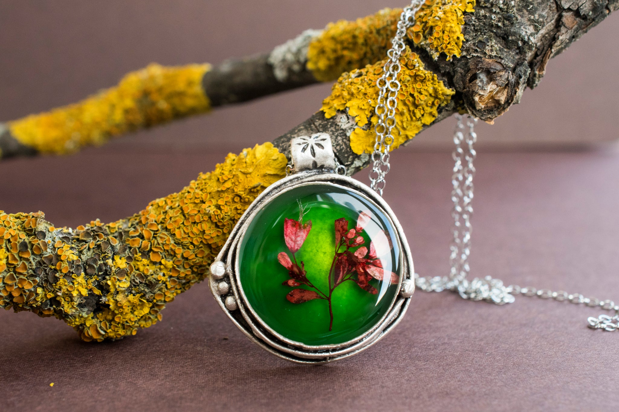 Green resin necklace with red flowers