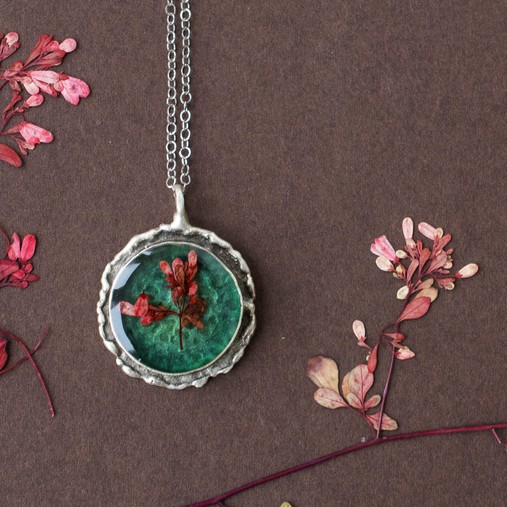 Dainty emerald pendant with red flowers