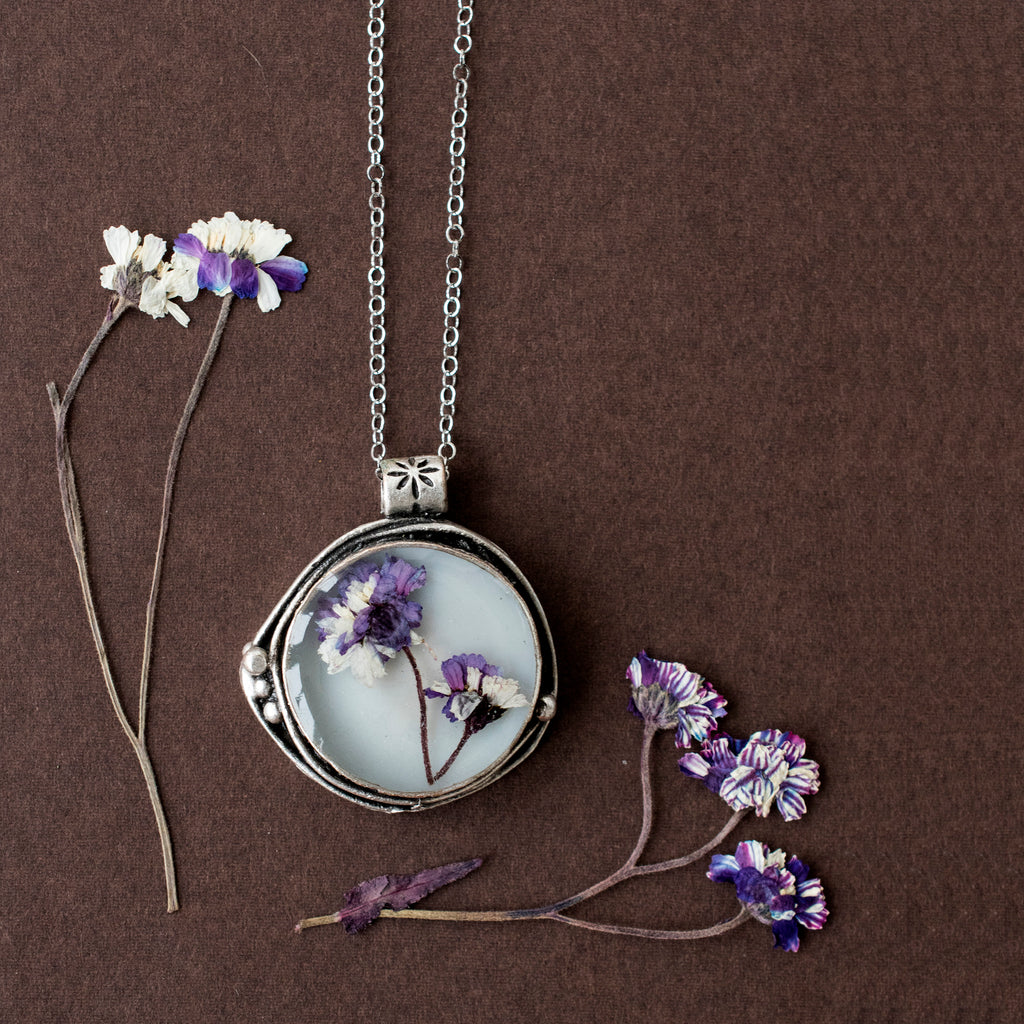 White pendant with purple flowers