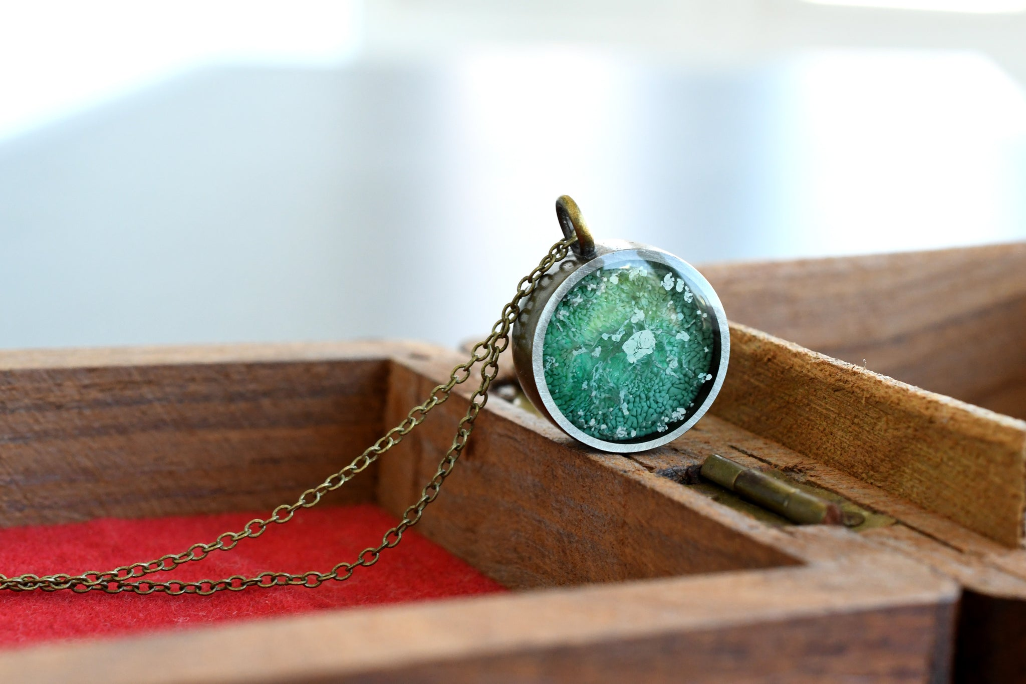 Two sided emerald pendant