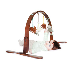 Dark birch wood scooter play gym – wonderful quality and made from sustainable, natural materials.