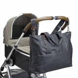 Storksak Changing Bag - Eden - Black Vegan Leather on pushchair