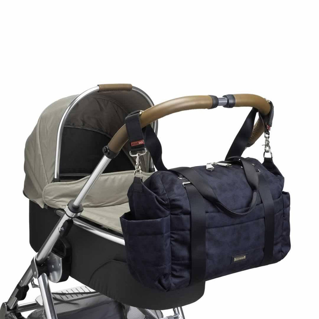 Storksak Changing Bag - Sandy - Print Blue on pushchair