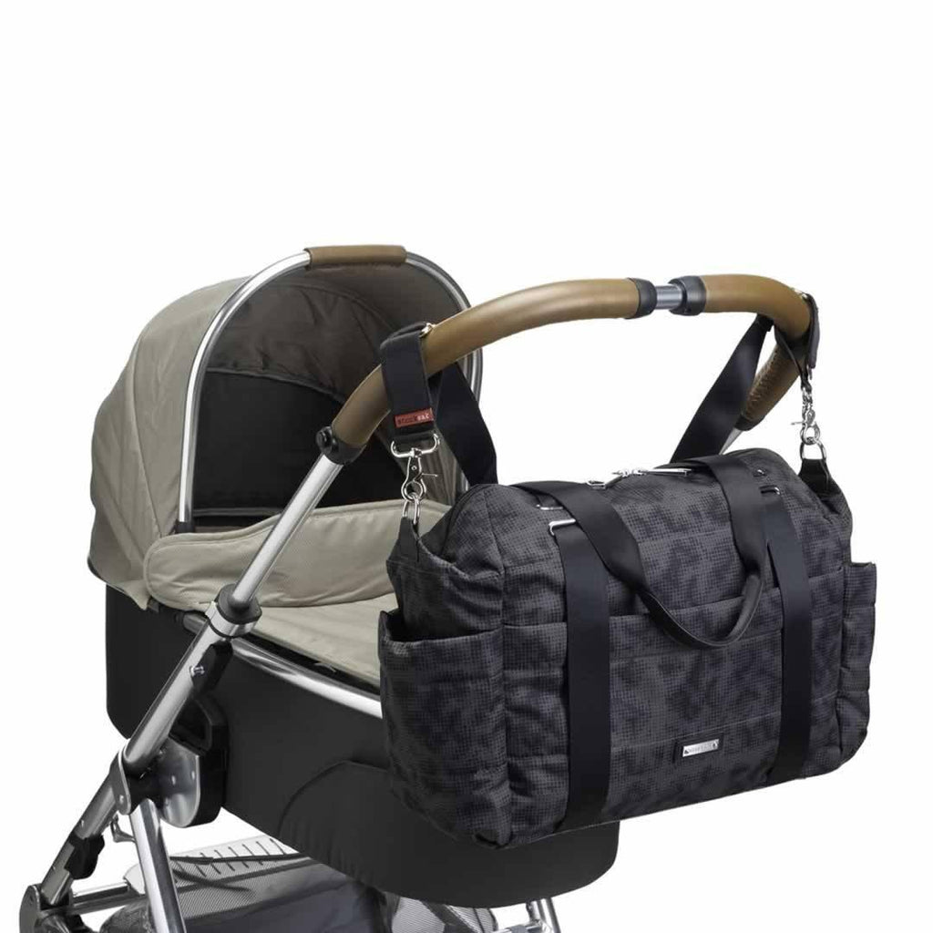 Storksak Changing Bag - Sandy - Print Grey on pushchair