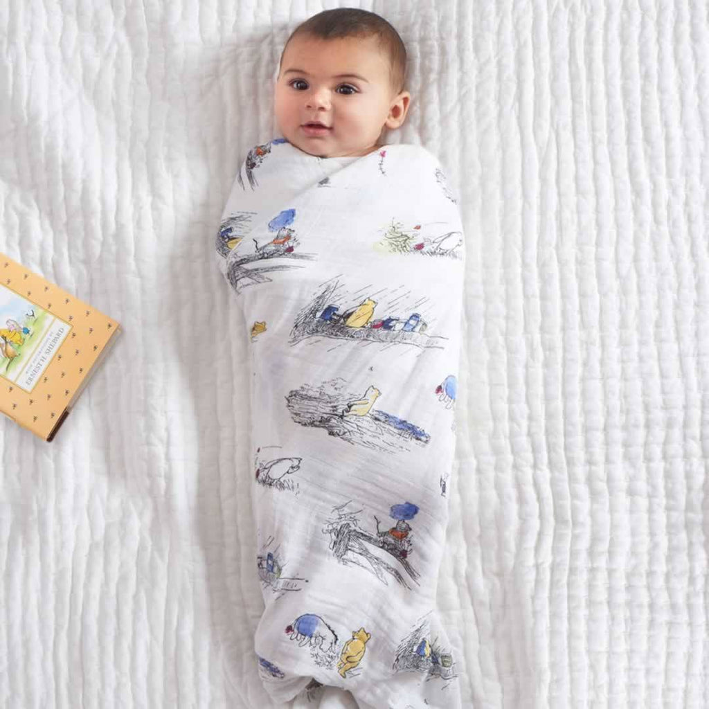 aden + anais Muslin Swaddles - Winnie The Pooh - 4 Pack Lifestyle