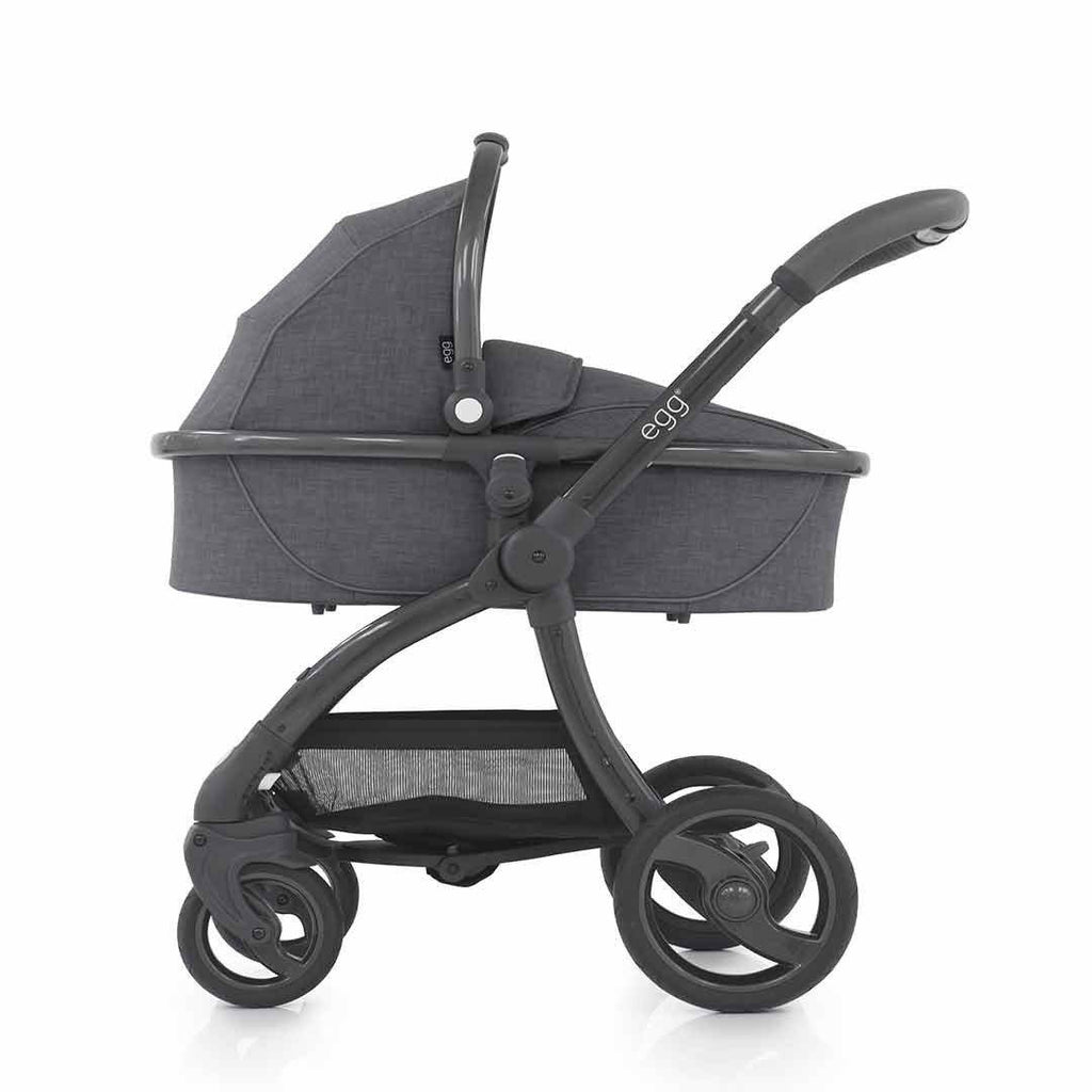 egg Carrycot - Gun Metal with Quantum Grey on pushchair
