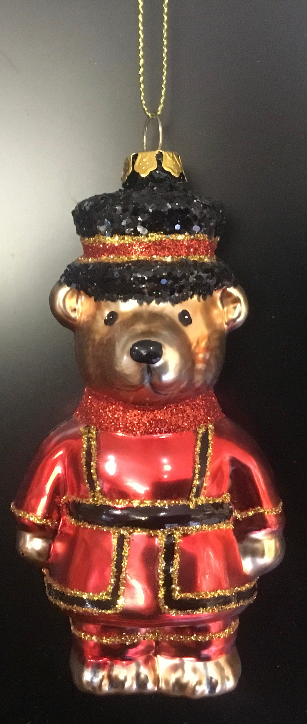 Beefeater Teddybear with black glitter hat.