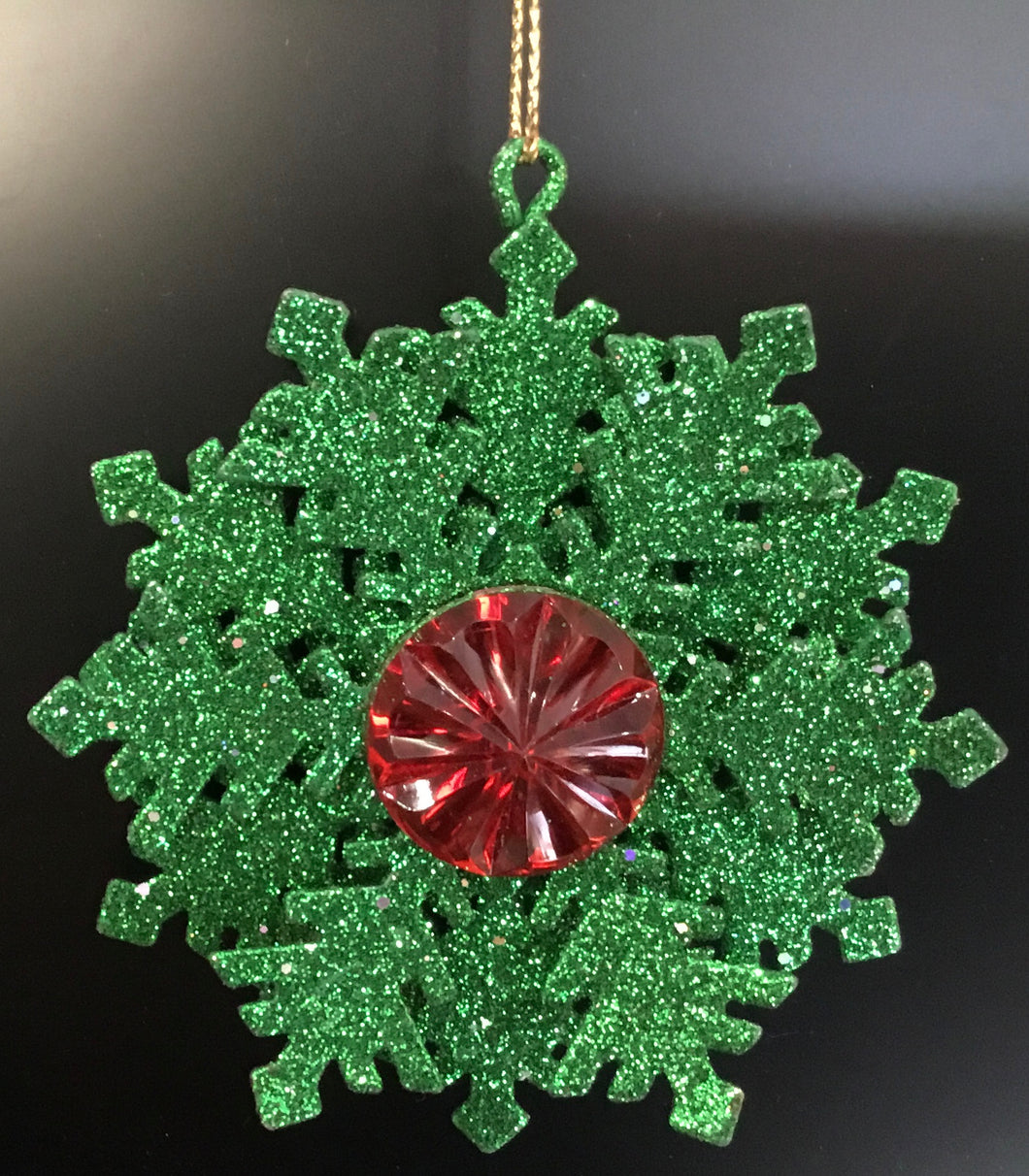 Green glitter snowflake with red jewell