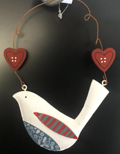 Tin robin on wire with hearts. White
