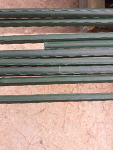 Green plastic coated metal spikes