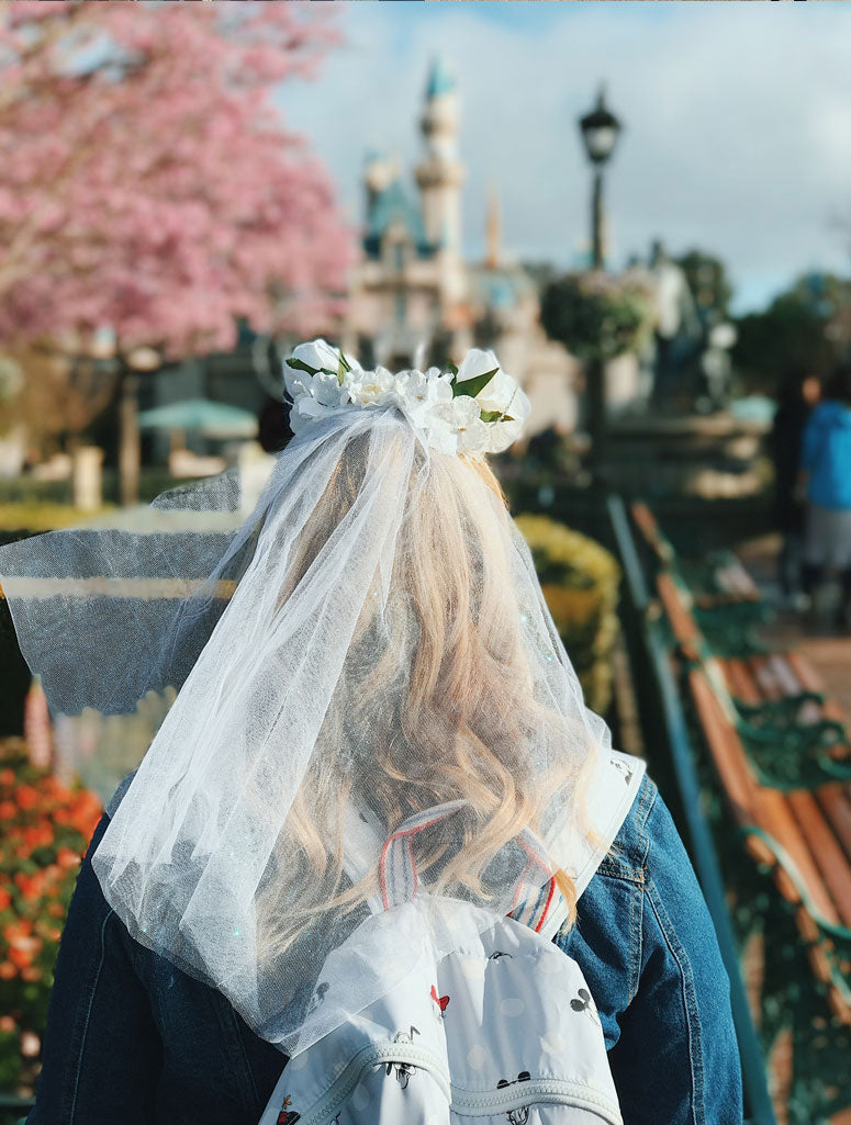 A bride at disneyland enjoying the view