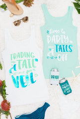 "Super cute ""Traded My Tail for a Veil"" and ""Time to Party Our Tails Off"" teal foil beachy mermaid bachelorette party shirts available at bachette.com"