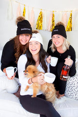 Bachelorette party wearing assorted winter pom-pom beanies by Bachette.com