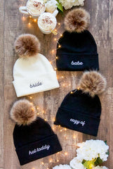 Winter bachelorette beanies reading bride, babe, cozy af, hot toddy by Bachette.com