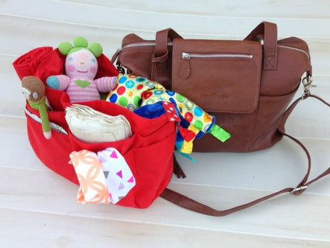 Baby Jack Lovey inside Lily Jade Diaper Bag