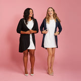 black and blue/grey belted sweater jackets over white dresses