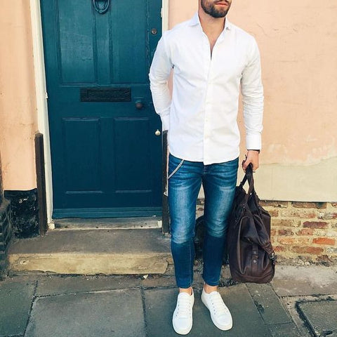 418b8b7ef0 ... over a nice pair of navy blue jeans with cool sneakers is a go-to  combination. Unbutton a few of your top buttons and add a duffel bag for the  perfect ...