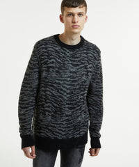KSUBI DISTORTION KNIT SWEATER IN BLACK