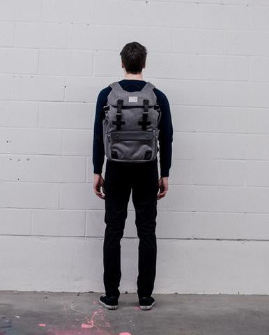 The biggest selection of backpacks satchels and murses in vancouver venque alpine rucksack in grey with black leather on model