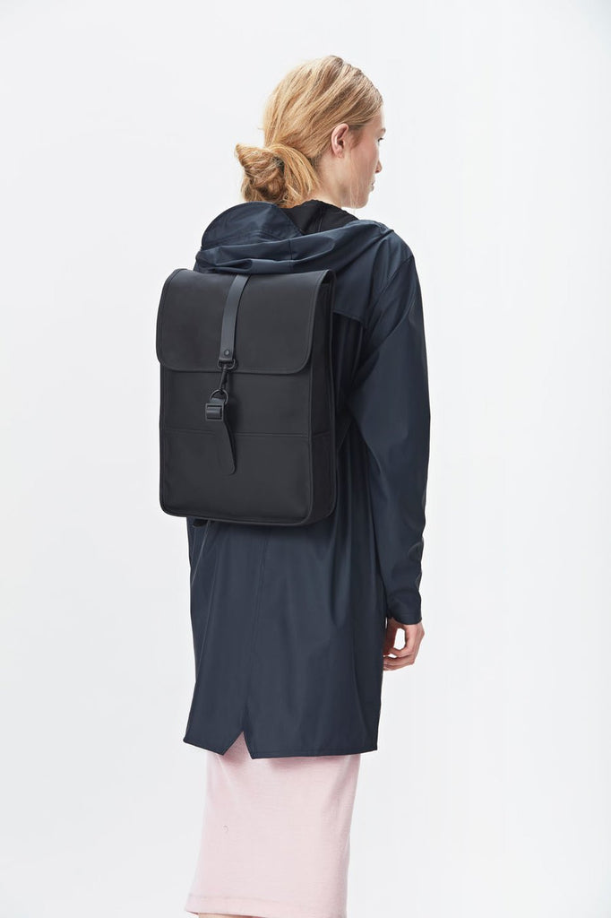 The biggest selection of bags satches murses and backpacks in vancouver Rains Waterproof Backpack Mini in Black on female model