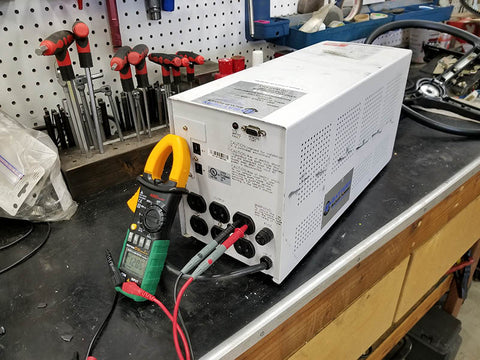 UPS With Replacement Lithium (LiFePO4) Batteries Undergoing Output Voltage Testing