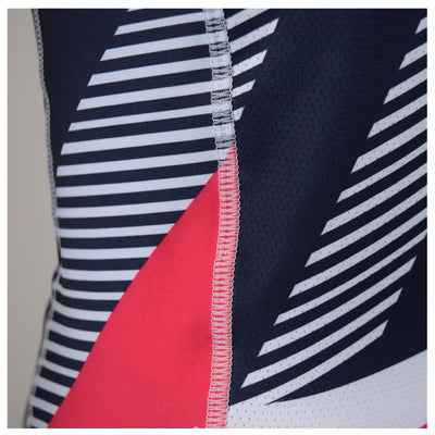 Female Cycling Jersey Red Geo Fabric Closeup