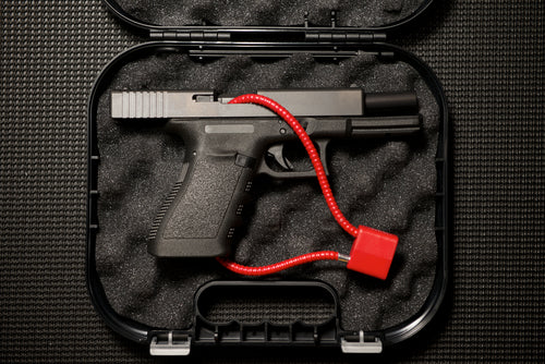 Handgun in Case With Cable Lock