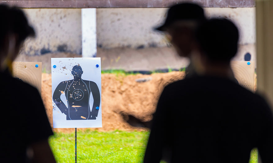 people target practicing guns