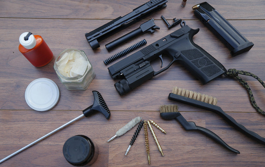 handgun with cleaning tools